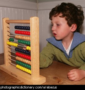 Photo of a boy using an abacus.