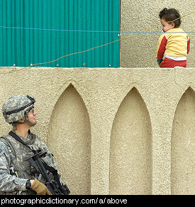 Photo of a child above a soldier