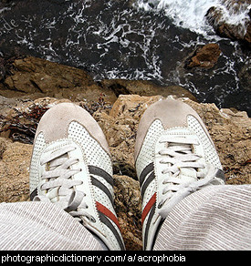 Photo of someone standing on a cliff edge