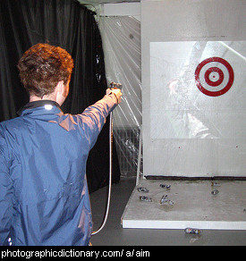 Photo of someone aiming at a target