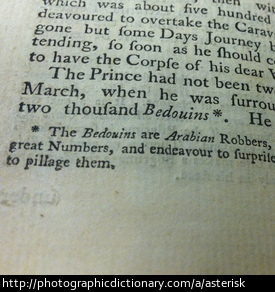 Photo of an asterisk on a footnote