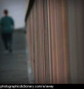 Photo of a man walking away