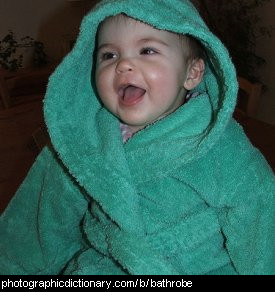 Photo of a child wearing a bathrobe