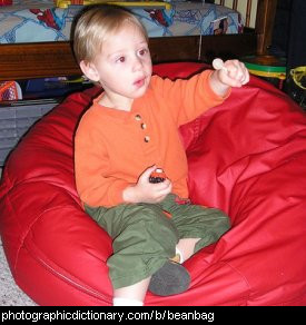 Photo of a child sitting in a beanbag