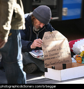 Photo of a man begging.