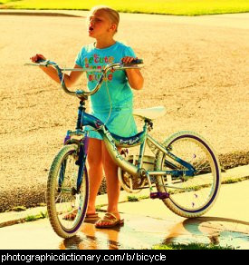 Photo of a girl and a bicycle