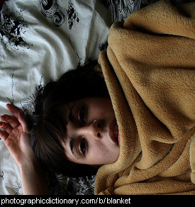 Photo of a girl under a blanket