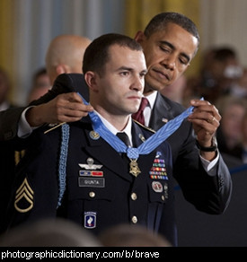 Photo of a man being awarded for bravery