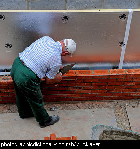 Photo of a bricklayer at work