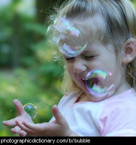Photo of a child blowing bubbles