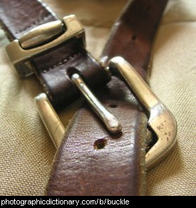 Photo of a buckle on a leather belt