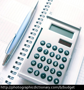 Photo of a calculator and pen