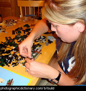 Photo of someone building something out of lego