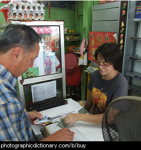 Photo of someone buying some goods