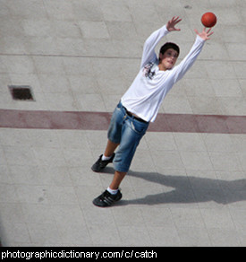 Photo of a boy catching a ball