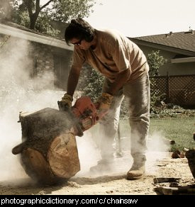 Photo of a man using a chainsaw