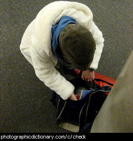 Photo of a man checking his bag