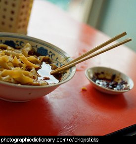 Photo of chopsticks in a bowl.