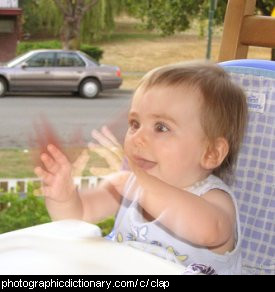 Photo of a baby clapping