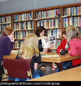 Photo of a group of teens in a library