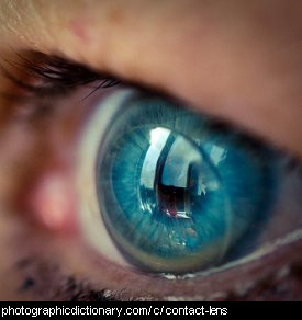 Photo of an eye with a contact lens