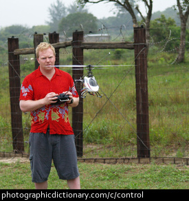 Photo of a man flying a remote control helicopter
