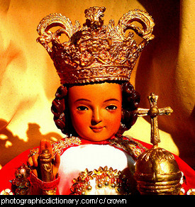 Photo of a doll wearing a crown.