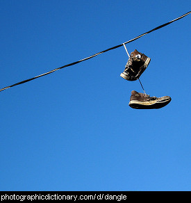 Photo of dangling shoes on a power line