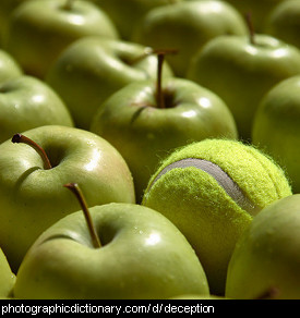 Photo of a tennis ball pretending to be an apple