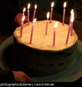 Photo of a cake with 11 candles