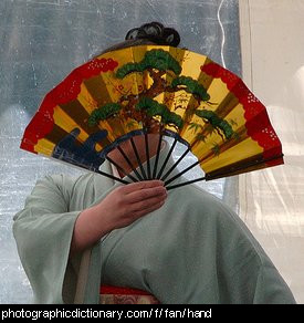 Photo of a woman holding a fan