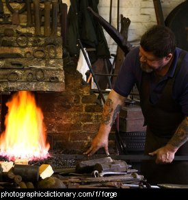 Photo of a blacksmith using a forge