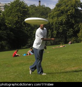 Photo of a man throwing a frisbee