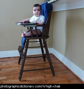 Photo of a baby in a high chair