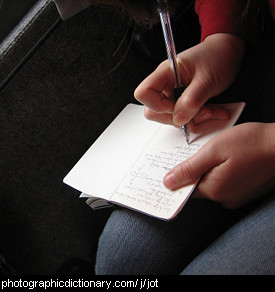 Photo of someone jotting down notes