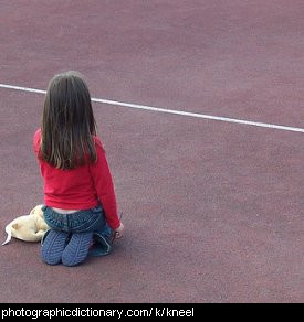 Photo of a girl kneeling