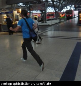Photo of a man running for the train