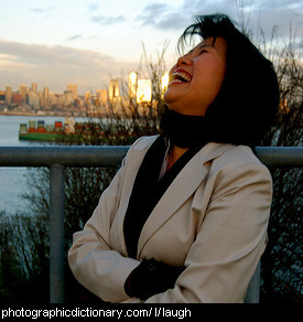 Photo of a woman laughing.