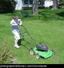 Photo of a boy mowing a lawn