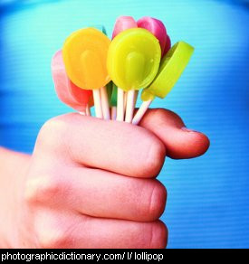 Photo of a child holding lollypops