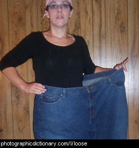 Photo of a woman wearing very loose jeans