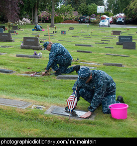 Photo of soldiers maintaining graves
