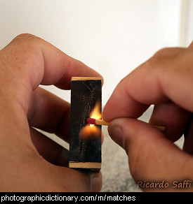 Photo of a match being lit