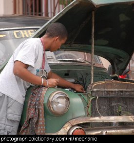 Photo of a mechanic fixing a car