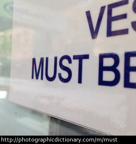 Photo of a sign that says must