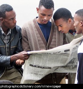 Photo of some men reading a newspaper