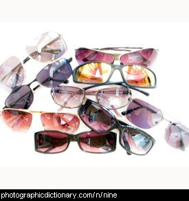 Photo of nine sunglasses.
