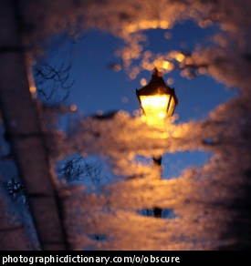 Photo of a lampost obscured by clouds
