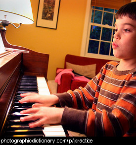 Photo of a boy practicing piano