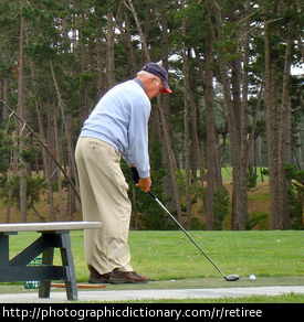 Photo of an older man playing golf